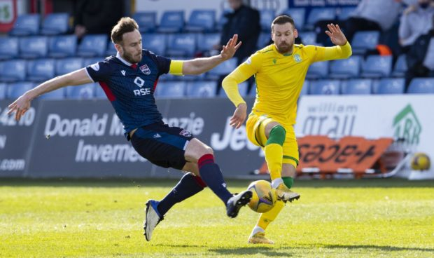 Keith Watson, left, battles for the ball with Martin Boyle