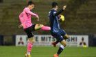 Daniel MacKay clips home the winning goal for Caley Thistle against Raith Rovers.