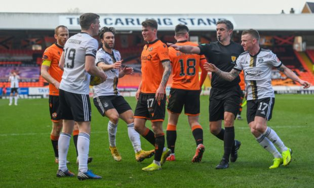 Dundee United's Jamie Robson takes issue with Aberdeen's Lewis Ferguson.