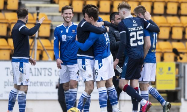 The St Johnstone players celebrate at full-time after beating Ross County on March 20 - the last time County played.