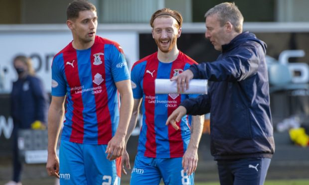 Caley Thistle midfielder David Carson with Robbie Deas and Barry Wilson.
