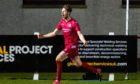 Martin Maclean celebrates his winner against Hearts for Brora Rangers.