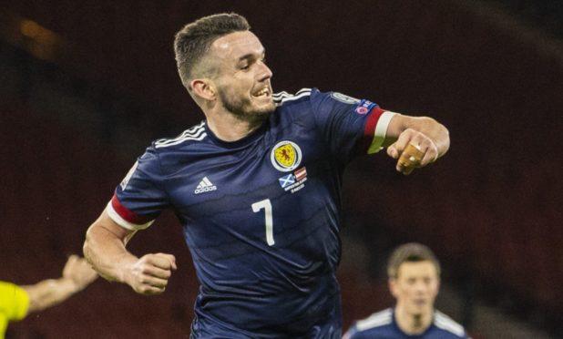 John McGinn celebrates netting for Scotland against Austria.