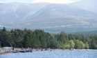Visitors at Loch Morlich, overlooked by the Cairngorms, last summer