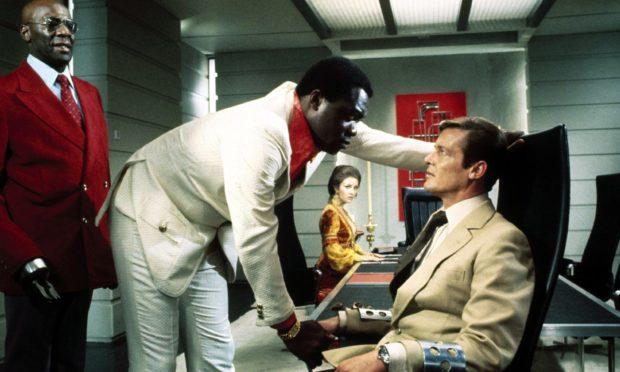 Scene from James Bond film Live and Let Die starring Julius Harris, Yaphet Kotto, Jane Seymour, Roger Moore.