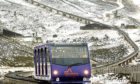 The funicular railway runs for two kilometers through the Cairngorm ski area.