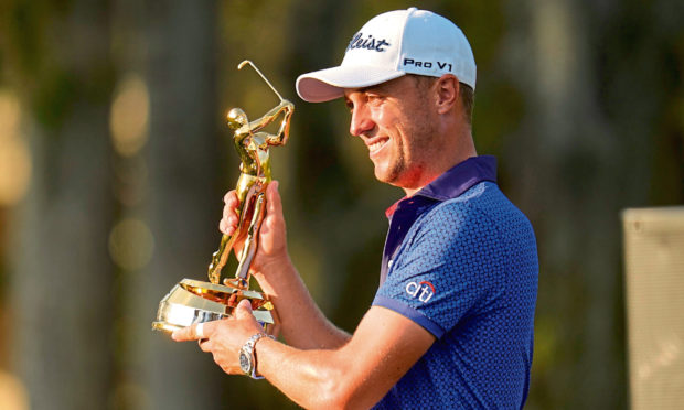Justin Thomas holds the trophy after winning The Players Championship.