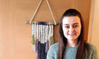 Alison MacDonald, who launched her business LotsofKnotts Macrame, producing custom macrame hanging decor and fibre rainbows, during lockdown.