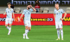 (Left to right) Scotland's Jack Hendry, Grant Hanley and Scott McTominay after conceding the opening goal during the World Cup qualifier between Israel and Scotland at Bloomfield Stadium, on March 28, 2021, in Tel Aviv, Israel.