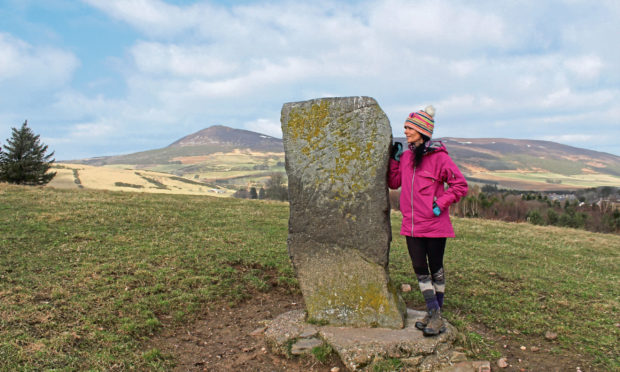 Gayle at the Craw Stane on the outskirts of Rhynie, with stunning views of Tap o' Noth.