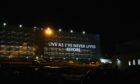 To go with story by Craig Munro. Quotes from NHS staff have been projected on the side of Aberdeen Royal Infirmary as part of a Covid art project. Picture shows; Aberdeen Royal Infirmary. Aberdeen Royal Infirmary. Supplied by Grampian Hospital Arts Trust Date; 27/02/2021