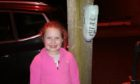 Aimee-Leigh Millar with her poop bag holder creations in New Pitsligo. Supplied by Emma-Russell