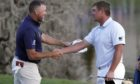 Lee Westwood and Bryson DeChambeau shake hands after they finished play in the Arnold Palmer Invitational.