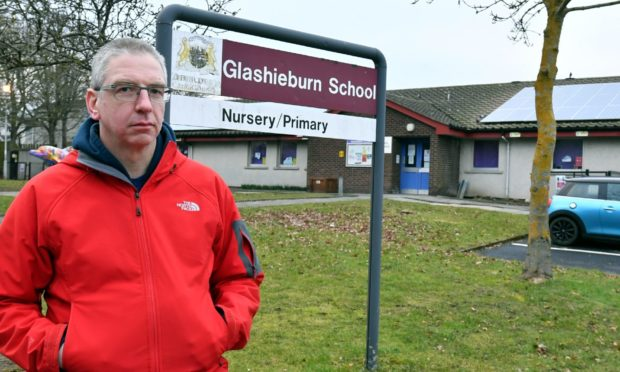Duncan Milne, chairman of Glashieburn Parent Council, is unhappy the school is to be used as a polling station.