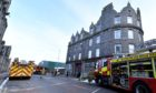 Three fire crews were called after a blaze was reported in the basement of a property in Torry