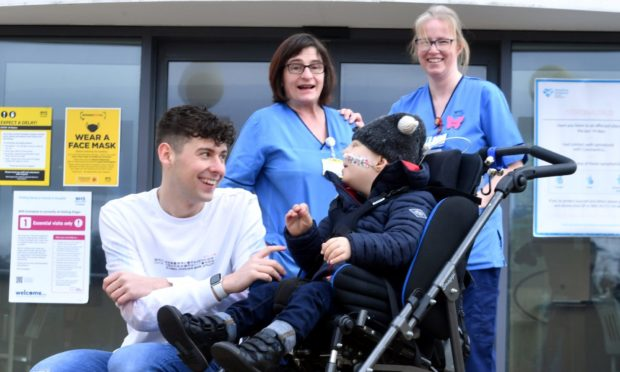 Donald Fraser, 21, with six-year-old Harris Morrison, chemotherapy practitioner Dorothy Farquharson and clinical nurse specialist oncology Karyn Ramsay.