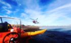 To go with story by Craig Munro. The coastguard in Moray has rescued a pair of kayakers who were trapped off the coast of Findhorn. Picture shows; Moray Coastguard helicopter. Findhorn, Moray. Supplied by HM Coastguard Moray Date; 28/02/2021