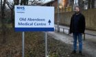"""Jonathan Juel-Beer and campaigners protesting change at Old Aberdeen Medical Practice have branded the investigation a """"whitewash"""""""