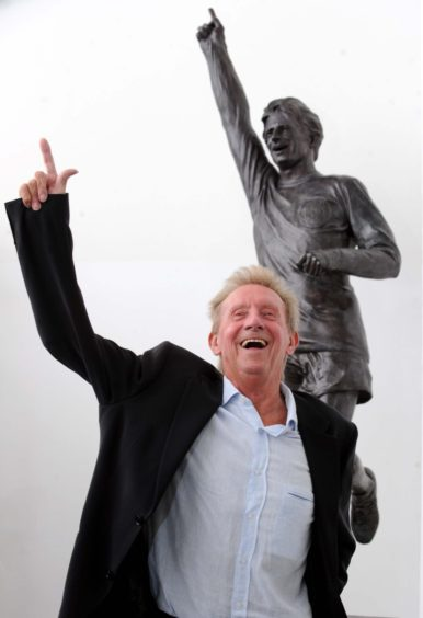 Denis Law at the unveiling of a statue in his likeness at Aberdeen Sports Village in 2012.