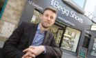 Donald Begg, outside his family's shoe shop in Inverness High Street in 2019