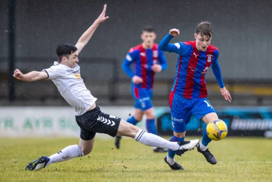 Caley Thistle midfielder Roddy MacGregor (right).