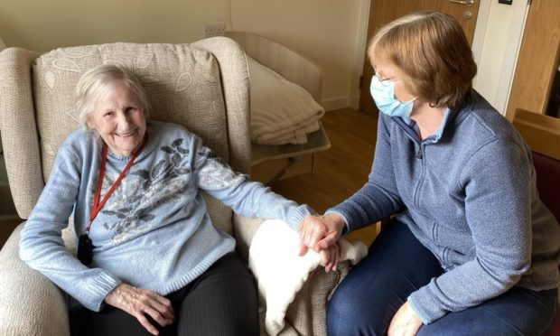 Edenholme care home resident Norah Peddie receives a visit from her daughter Anne Chalmers.
