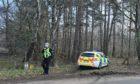 Police at Brumley Brae in Elgin this morning.