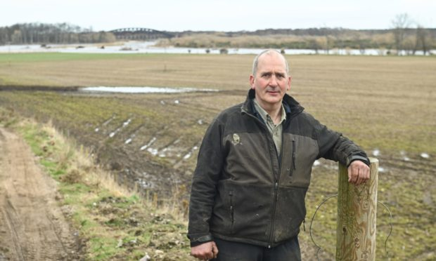Farmer Angus Fettes is appealing for more maintenance to be undertaken on the River Spey to reduce flooding.