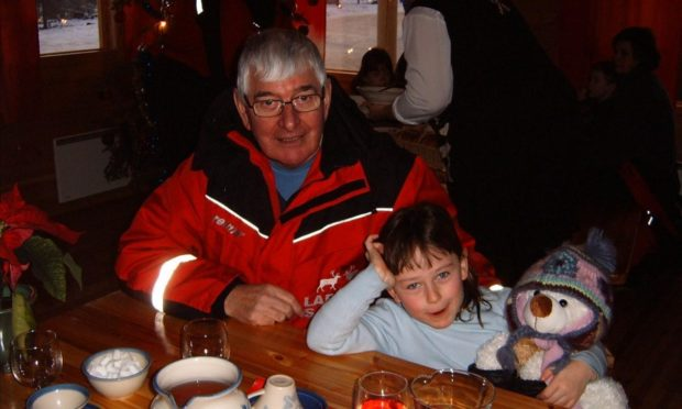 Jenna Rattray and her late grandfather Alan on a Christmas trip to Lapland back in 2006.