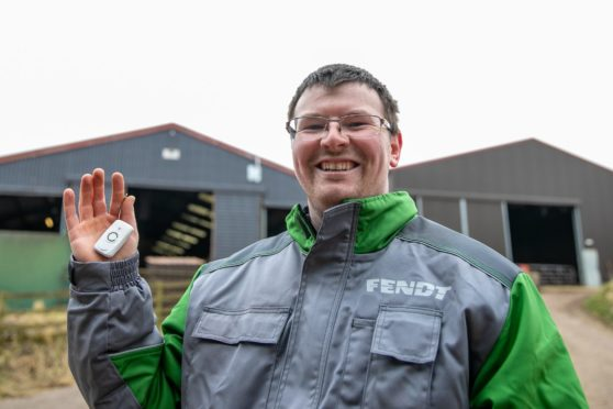 FARM SAFETY: Stephen Brown with the solo alarm he carries in case of an accident.