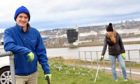 Crawford Paris, from the Turning the Plastic Tide group, has teamed up with the Greyhope Bay team to install a new shoreline litter-picking kit box at Torry Battery, so visitors to the site can use the gloves and bags provided to safely clean up rubbish from the area while they visit.   Pictured -  Crawford Paris alongside Fiona McIntyre from the Greyhope group. Picture by Kami Thomson / DCT Media         29-03-2021`