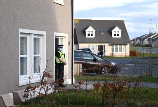 CR0027239  A baby was taken to hospital from an address on Strachan Way in Peterhead just before midday today, and police are still in attendance at the house.  Pictured is the house with the policeman on duty  Picture by Paul Glendell     23/03/2021