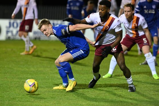 Peterhead defender Jason Brown in action against Stenhousemuir in the Scottish Cup.