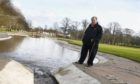 Councillor Bill Cormie is concerned about the cost of clearing the pond in Westburn Park, which has been turned red-orange three times in recent weeks by silt.