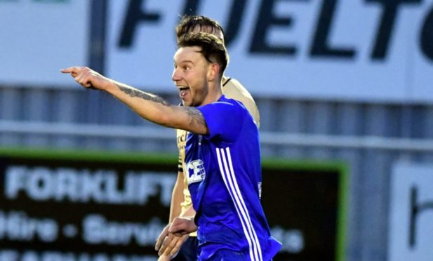 Mitch Megginson celebrates a goal against Forfar Athletic.