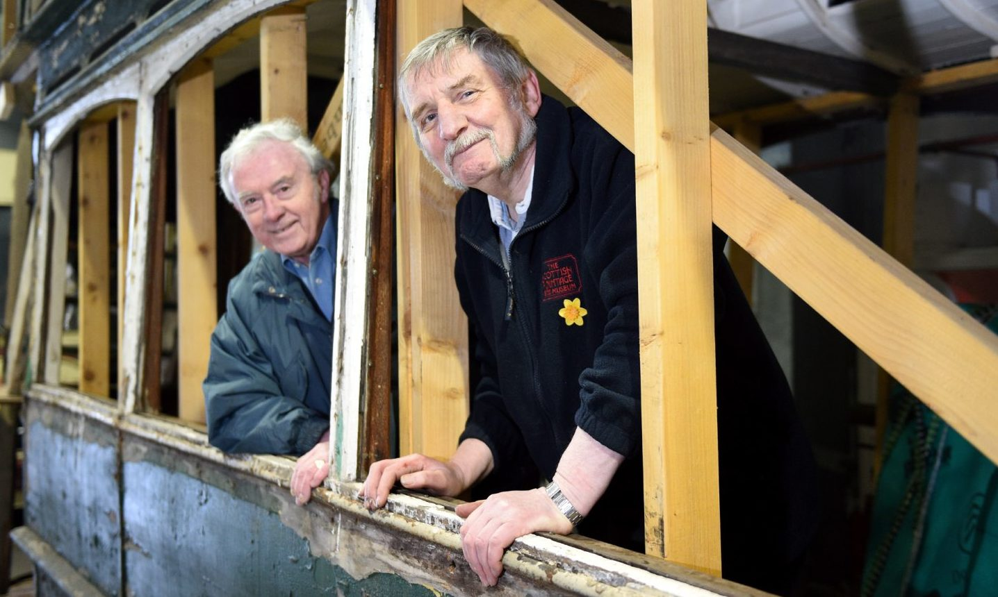 Joe Mackie and Ian Souter, from The Aberdeen and District Transport Preservation Trust, with a 1901 tram car.