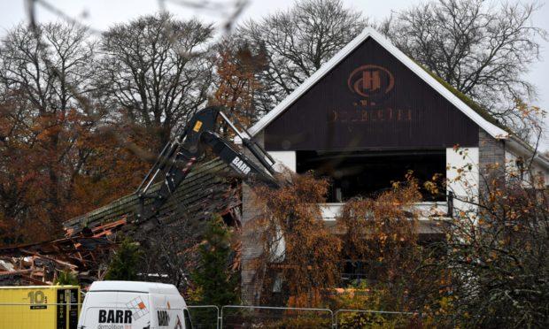 Demolition of the former Hilton Treetops Hotel in Aberdeen began in November
