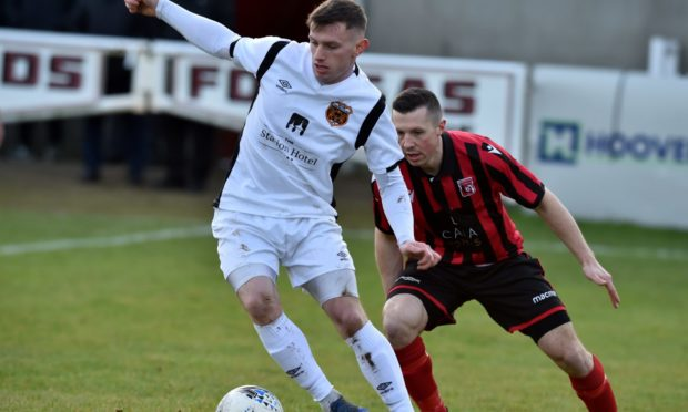 Alis Sutherland in action for Rothes against Inverurie Locos.