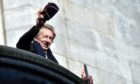 Denis Law waves to the thousands who lined the streets for his Freedom of the City parade in November 2017.