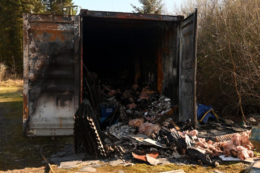 Damage at Somebody Cares container in Hazelhead. which was set on fire.