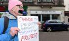 Protestor Simon Clark on Forres High Street.