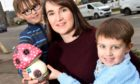 Flo Skinner of Nairn with her two sons, Brodie (7) and Louis (4) and one of the 70 'Fairy doors'