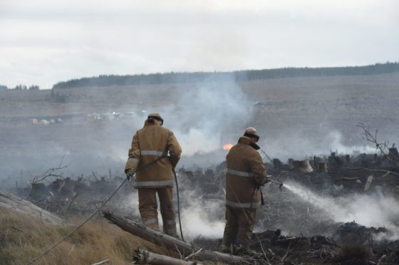 Firefighters deal with a wildfire near Dava in April 2019.