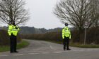 Police close off a road in Kent during the search for Sarah Everard. Gareth Fuller/PA Wire