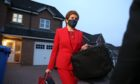 Nicola Sturgeon pictured leaving her home prior to giving evidence to the Scottish Parliament's inquiry.