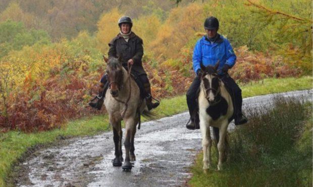 Intrepid Perthshire horse rider Karen Inkster on Monty and TV explorer Paul Murton on Connie.