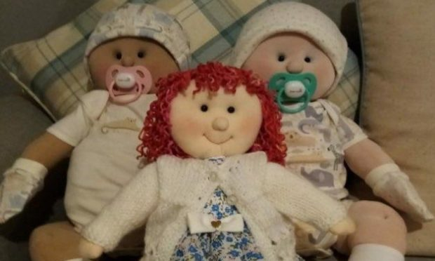 Hundreds raised for care homes through rag doll raffle