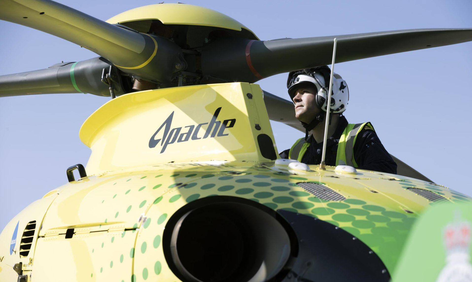 Captain Pete Winn checks the rotor head on Helimed 79.
