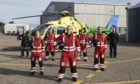 The Aberdeen-based Scaa team in front of Helimed 79 Pictured from left, pilot Jon Stupart, paramedic Laura McAllister, paramedic Chriss Doyle, lead paramedic Ewan Littlejohn, paramedic Rich Forte, paramedic Owen McLauchlan, and pilot Pete Winn