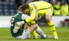 Hibernian's David Gray (left) with Ross County's Gary Woods at full-time.